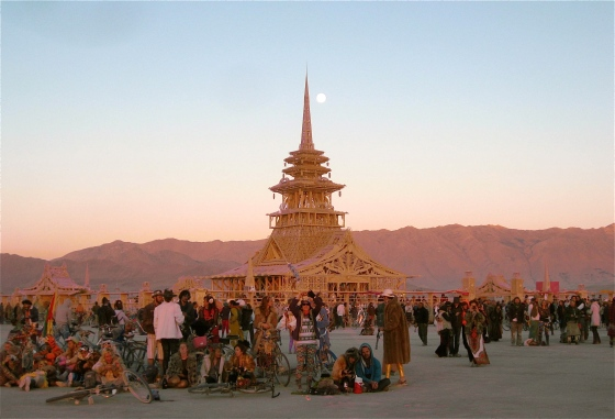 People gathered around the Temple of Juno at sunrise.