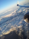 Plane wing and clouds.