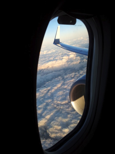 View from a plane window of the sky.