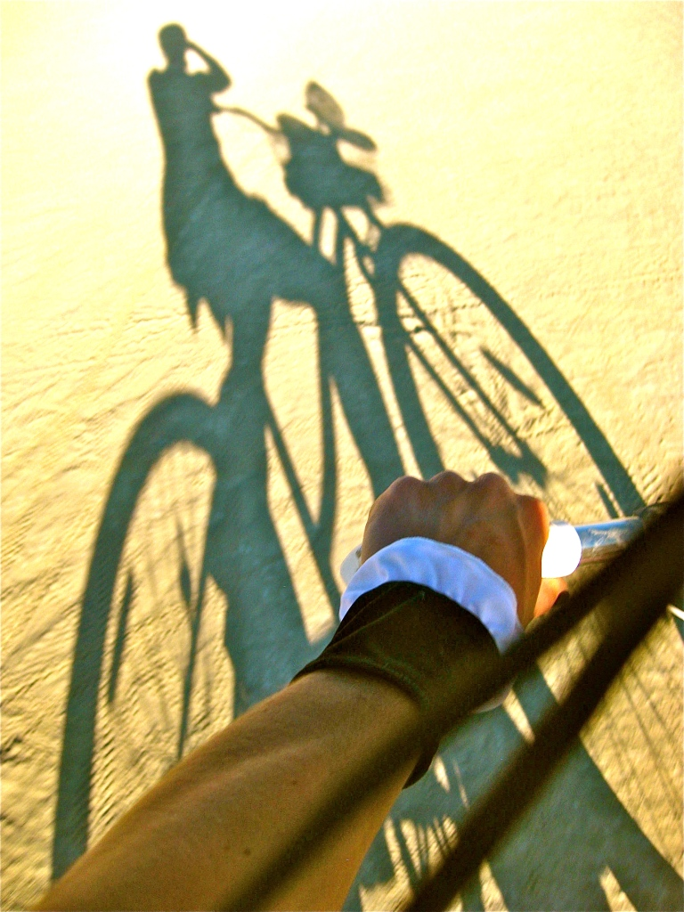 Chasquita's shadow cycling across the playa.