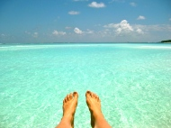 Chasquita's toes and the turquoise ocean in the Maldives.