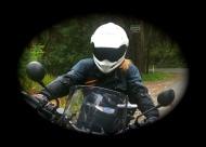 Chasquita on a motorbike.