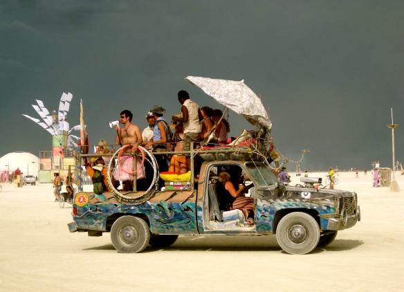 Vehicle with people on.
