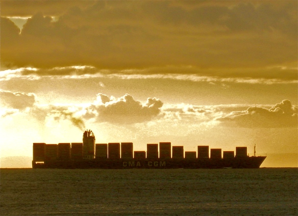 Container ship sailing across the horizon.