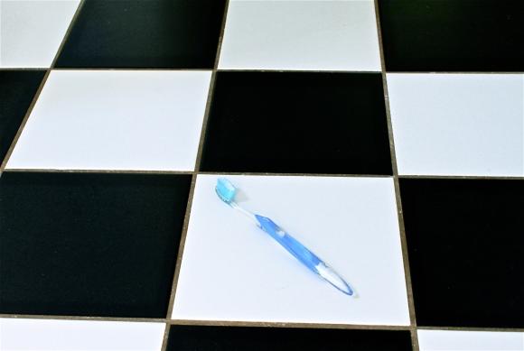 Toothbrush on the bathroom floor.