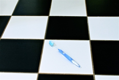 Toothbrush on the bathroom floor.